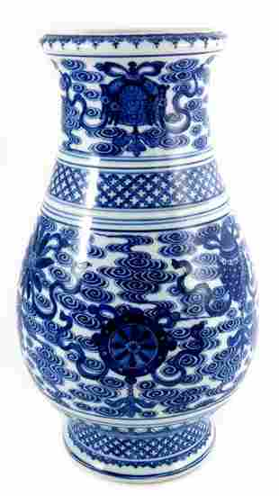 A Chinese blue and white vase baluster form painted