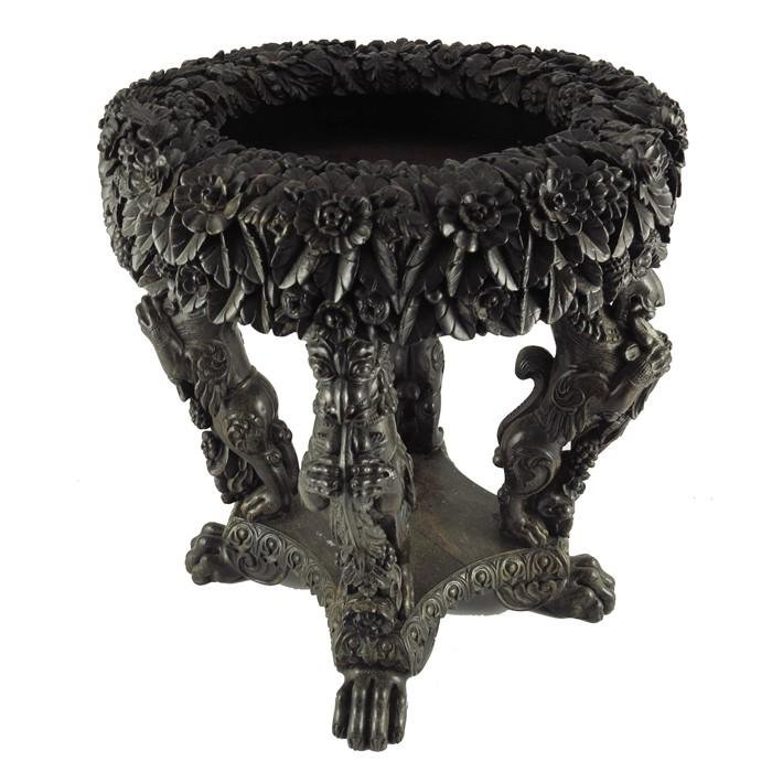 An Indonesian carved hardwood jardiniere stand,