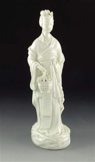 A Chinese blanc de Chine figure modelled as a woman