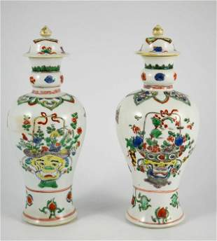 A pair of Chinese famille vert baluster vases and
