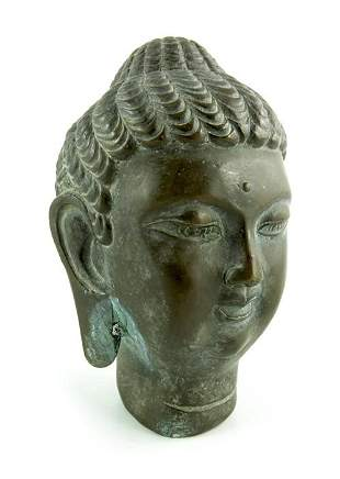 A Chinese bronze Buddha head cast in relief seal mark