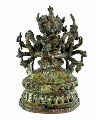 A Tibetan gilt bronze figure group of Chakrasamvara