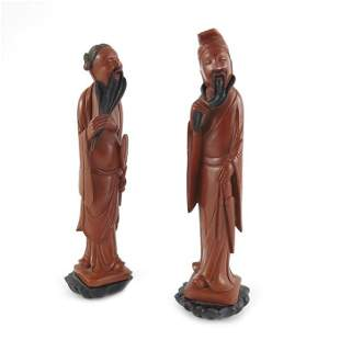 A pair of Chinese carved figures of Immortals late