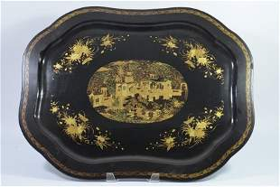A Chinese lacquer tray decorated with a figural garden