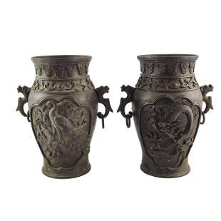 A pair of Japanese bronze vases inverse baluster form