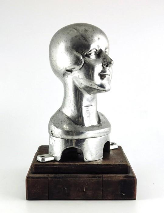 An Art Deco cast white metal mannequin or millinery