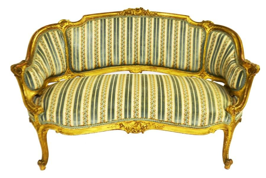 A Louis XV style carved giltwood settee, three panelled
