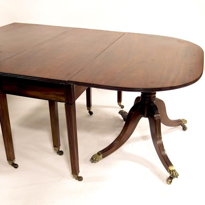 A large George III mahogany D end dining table, circa