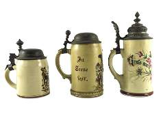 Three steins including a Mettlach Villeroy and Boch