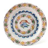An English Delft polychrome charger, mid 18th century,