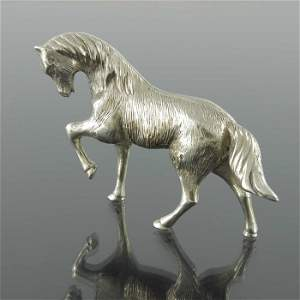 An Iraqi silver model of a horse, realistically