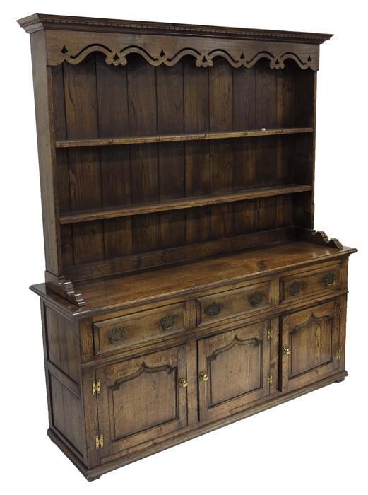 A George III style oak dresser and rack, the three bay