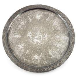A large Indian white metal tray, circular form, chased