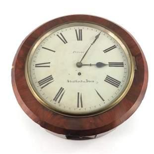 A Victorian mahogany wall clock Pearce of Stratford