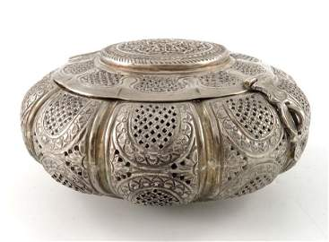 An Indian white metal reticulated incense box, squat