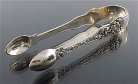 A pair of Victorian silver sugar tongs, George Adams,