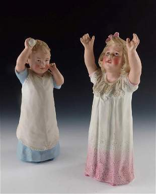 A pair of Gebruder Heubach bisque figures of young