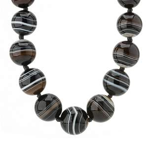 A late Victorian graduated banded agate bead necklace,