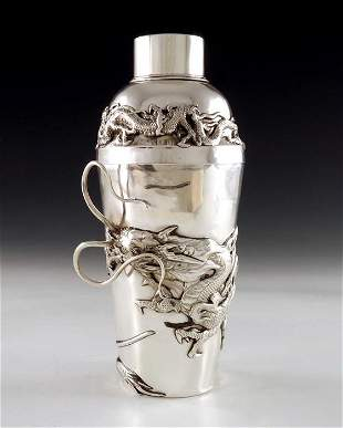 A Chinese silver cocktail shaker, circa 1920, the body