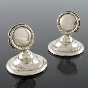 A pair of Edwardian silver menu holders, Elkington and