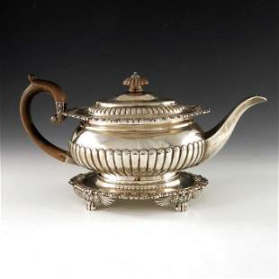 A George III silver teapot on stand, J E Terrey and