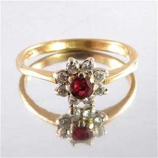 A ruby and diamond cluster ring on 18 carat gold band,
