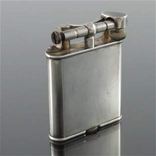 Alfred Dunhill, a New Dunhill lift arm lighter, silver
