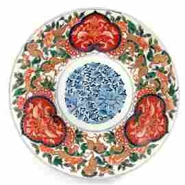 A large Japanese Imari charger, Meiji, painted with a