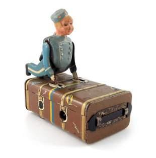 A Schuco Express Boy clockwork tin toy, modelled as a