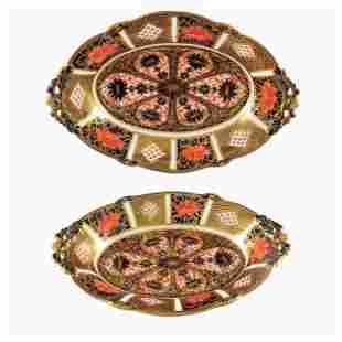 A pair of graduated Royal Crown Derby Imari 1128 oval