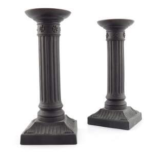 A pair of Wedgwood black basalt candlesticks, circa