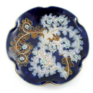 George Tinworth for Doulton Lambeth, a stoneware plate,