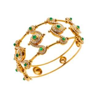 An 18ct gold emerald cabochon and brilliant-cut diamond