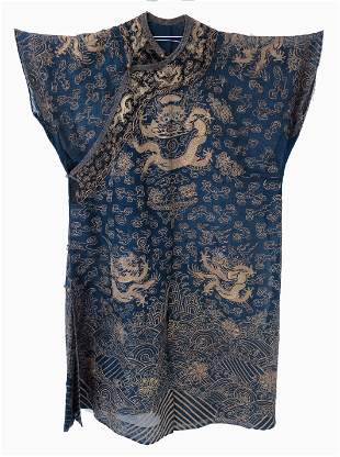 A Chinese silk dragon robe richly embroi