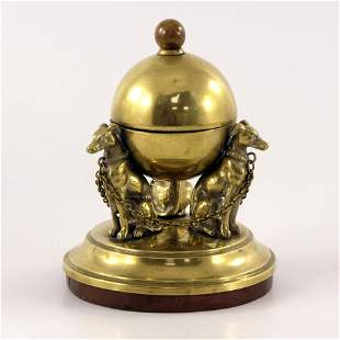 A Victorian brass inkwell, modelled as t