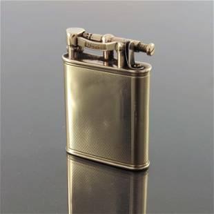 Alfred Dunhill, a 9ct gold Unique lift a