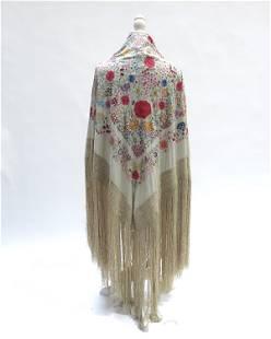 A cream silk Chinese Canton shawl embroi
