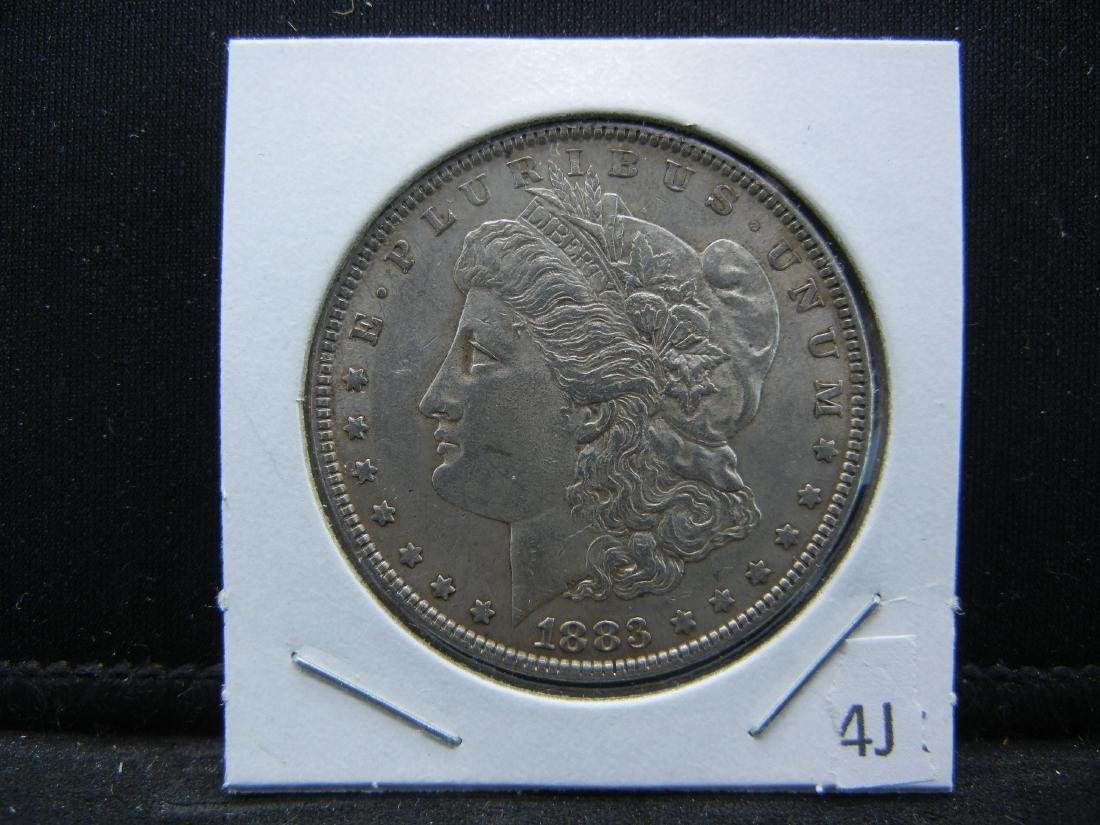 1883 Morgan Silver Dollar. Nice UNC Full feathers! - 3