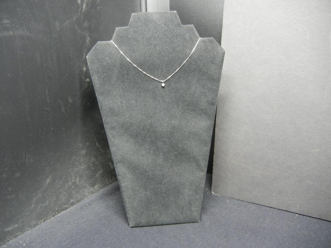 2 Rings, a Pendant and a Necklace (Necklace says - 10