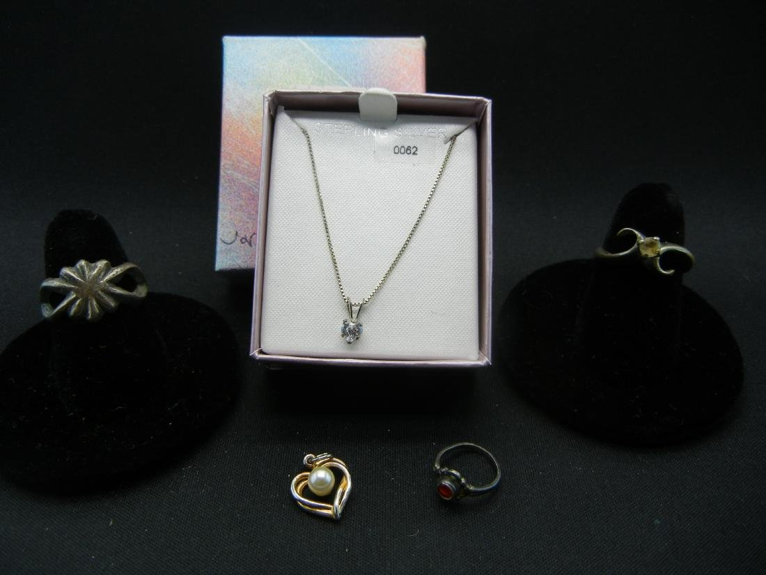 2 Rings, a Pendant and a Necklace (Necklace says