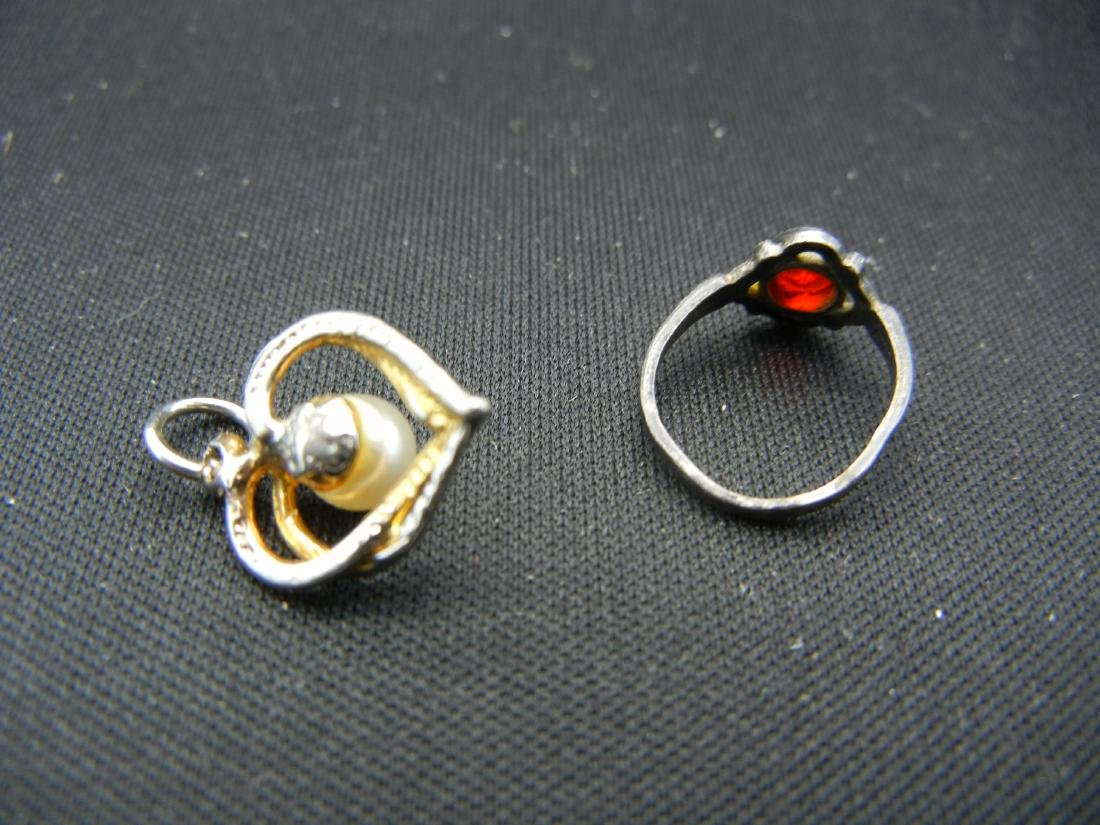 2 Rings, a Pendant and a Necklace (Necklace says - 3