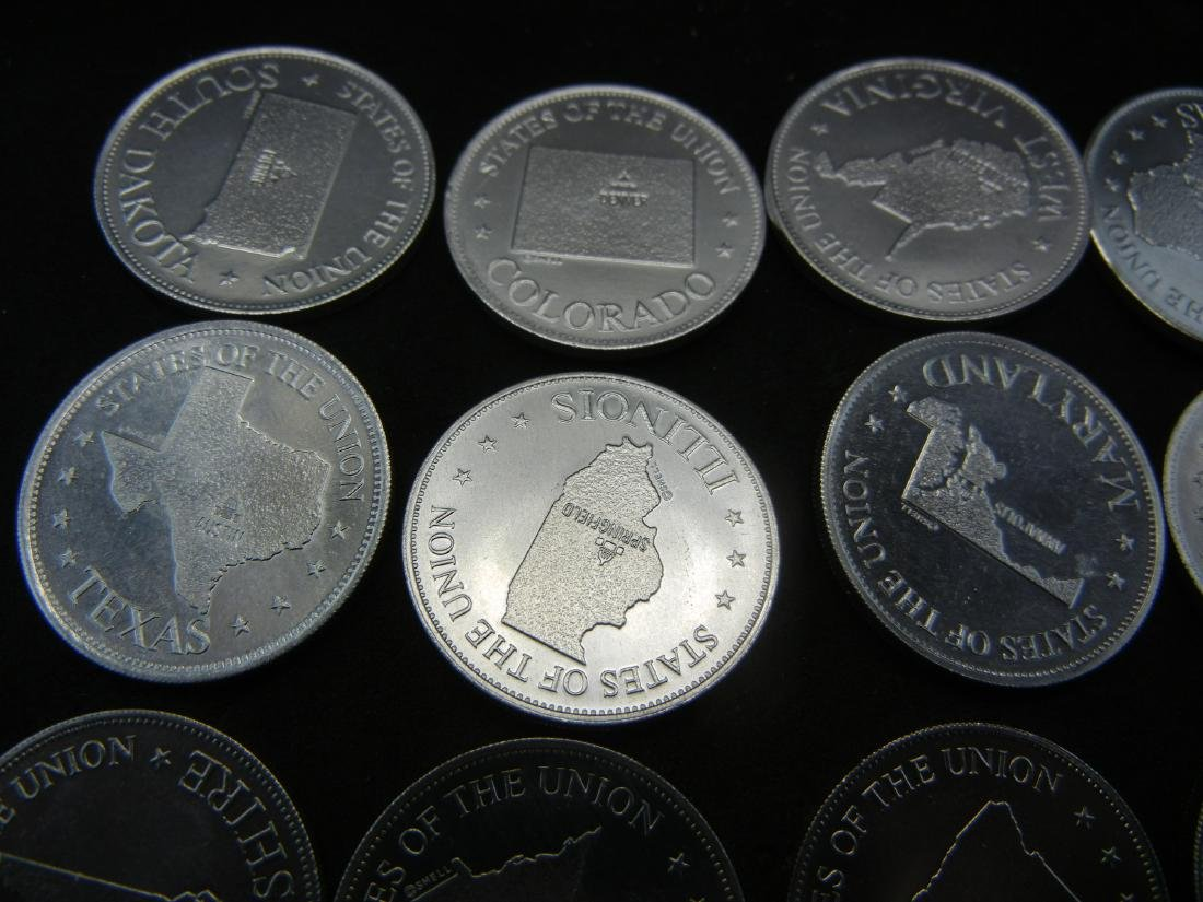 Bag of US State Gas Station tokens. Collect em all! - 2