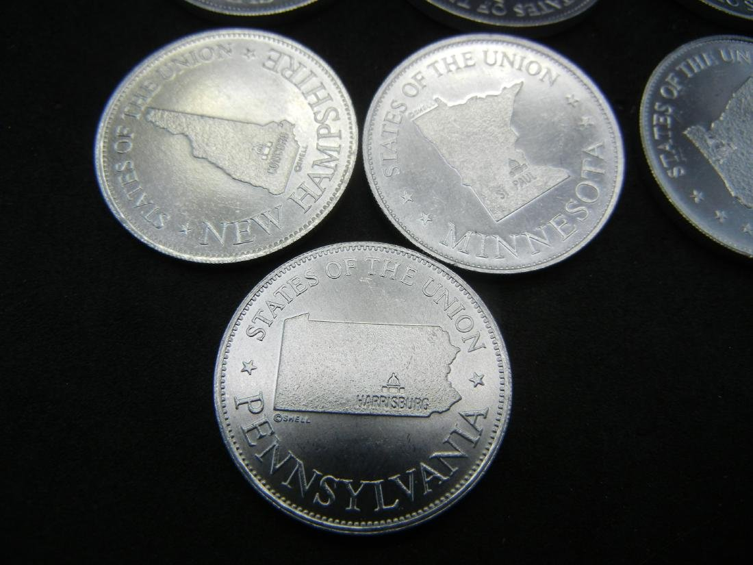 Bag of US State Gas Station tokens. Collect em all! - 4