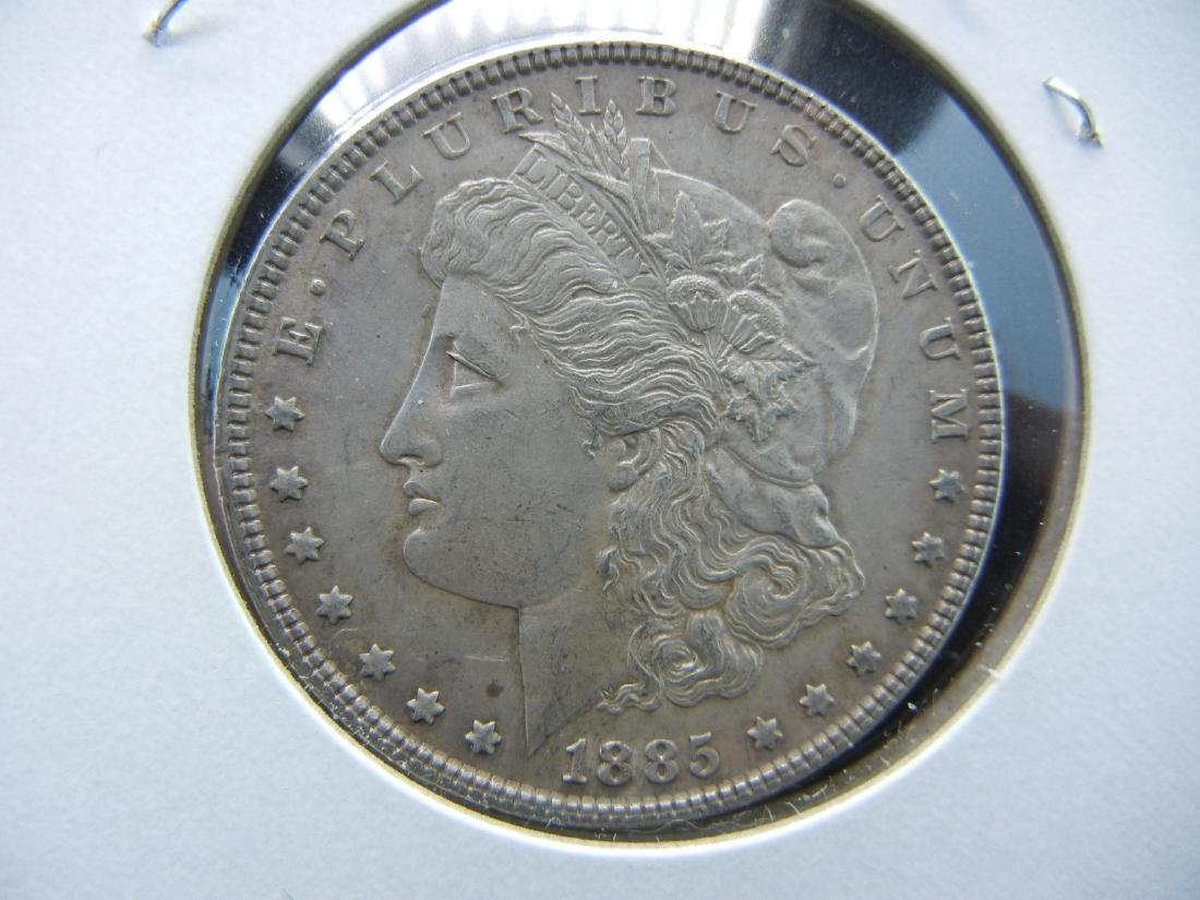 1885 Morgan Dollar. FULL FEATHERS. Unc. Clean cheek! - 2