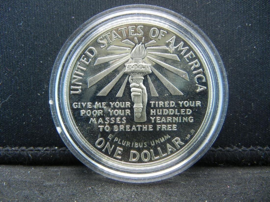 1986-S Ellis Island Silver Proof Dollar. Govt capsule.