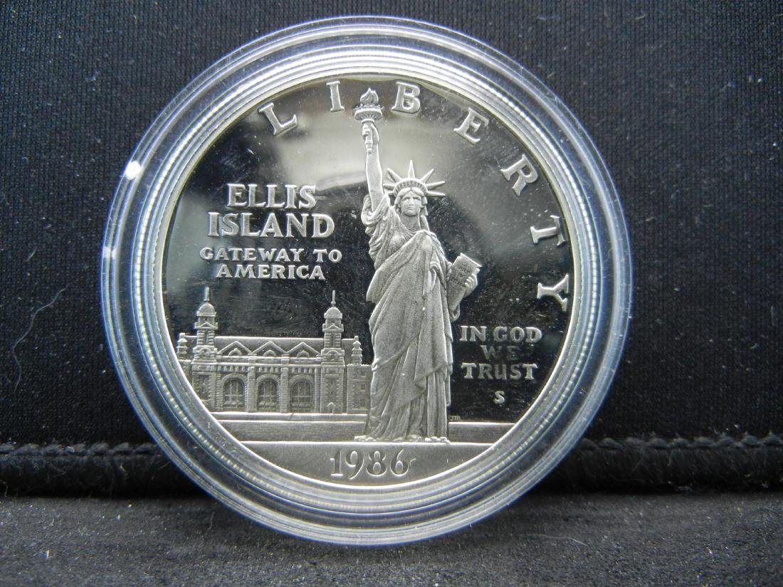 1986-S Ellis Island Silver Proof Dollar. Govt capsule. - 2