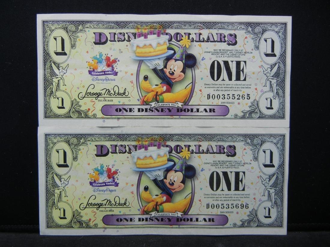 2 Sparkely DISNEY Dollars.