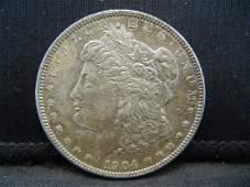 1904 O Morgan Dollar AU+ Toned
