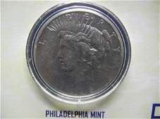 High Grade 1928 Peace Dollar in 1st Commemorative Pkg