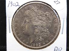 1902 Morgan $1. AU. Very tough Philly date.